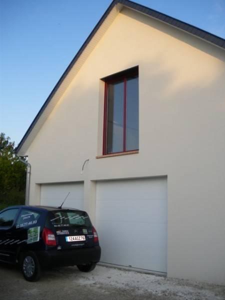 Pose de porte de garage sectionnelle par miroiterie for Poseur de porte de garage sectionnelle